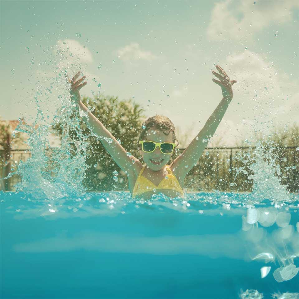 Child having fun in swimming pool.