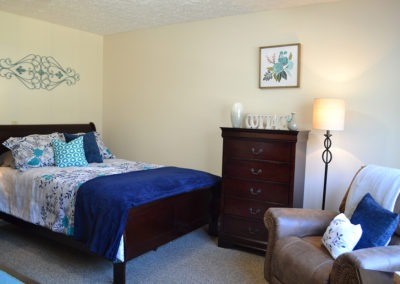 Comfortable Bed, Dresser for storage, and a big comfy chair