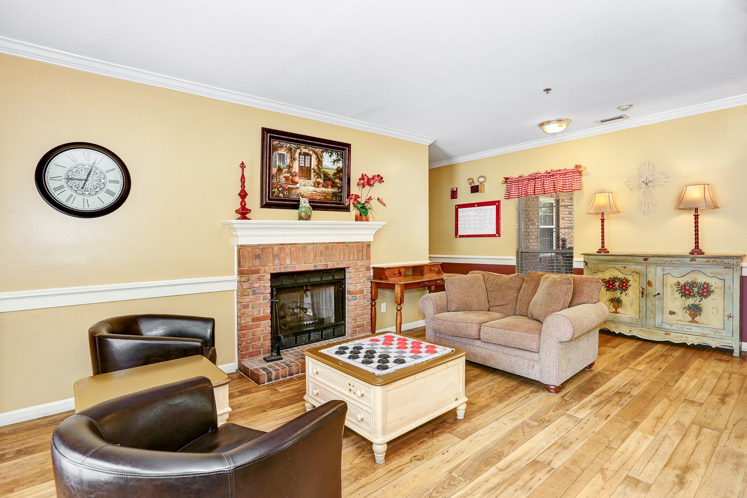 Country Cottages Hoover - Common Area with checkers and fireplace