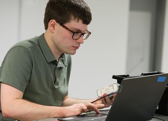 The Precision Institute student at laptop