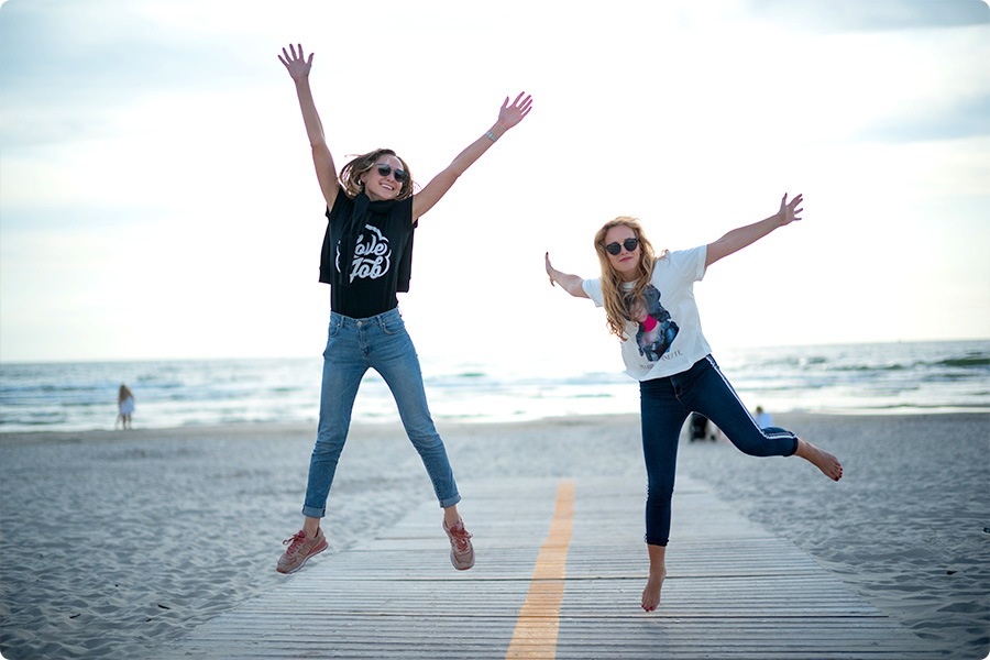 2 women jumping in joy compressed