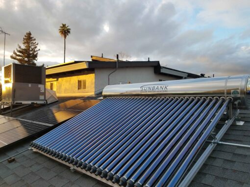 Photo of a Sunbank 80 gallon system flush mounted on a comp shingle roof at sunset