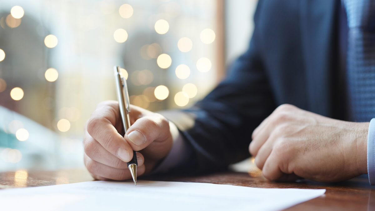 Entrepreneur signing business contract or agreement