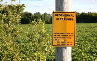 post with sign saying geothermal heat pumps.