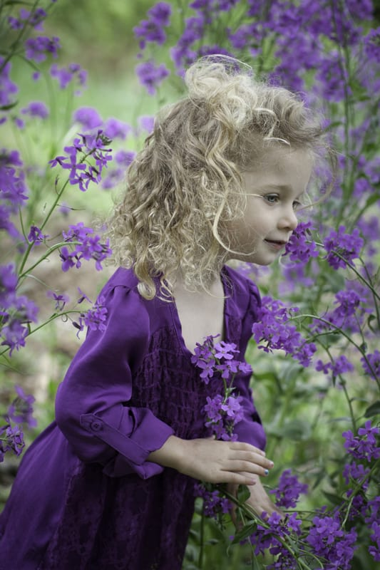 little girl in field of purple flowers
