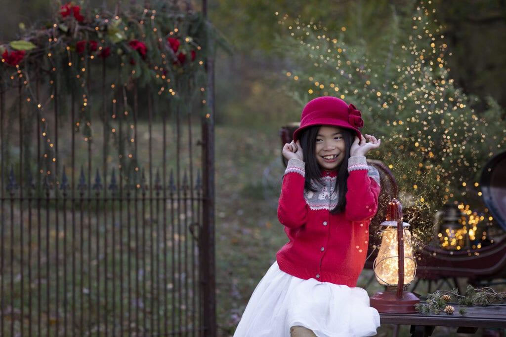 girl in festive holiday lights