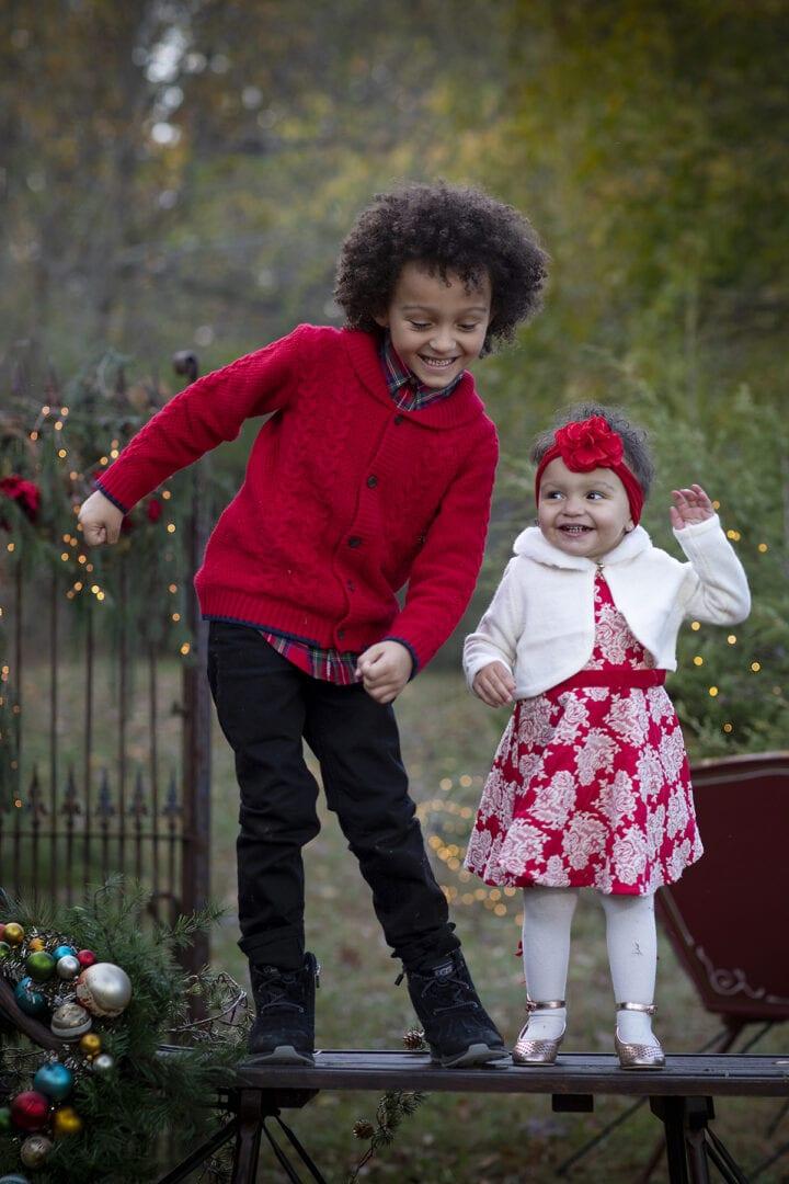 Brother and sister on Christmas sleigh