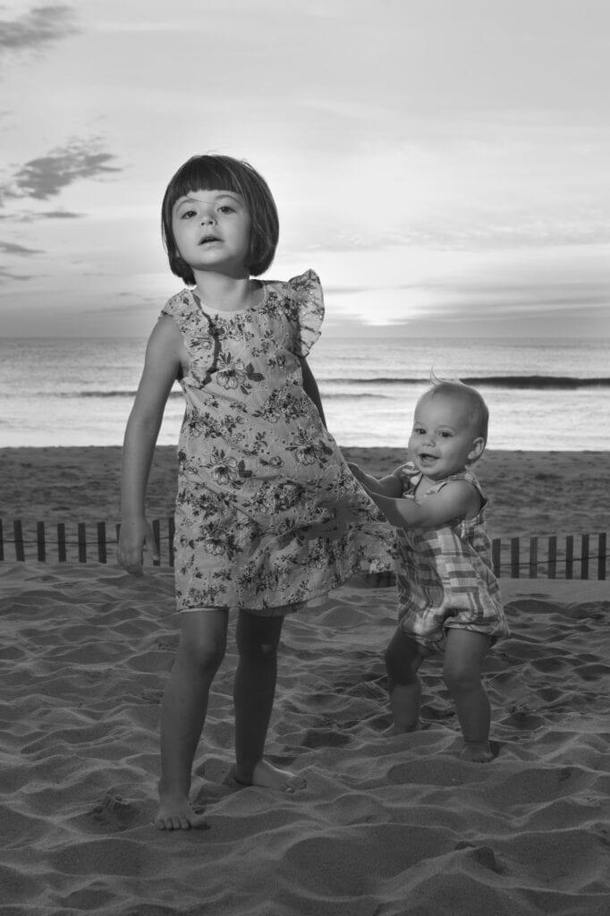 small girls on beach at sunrise