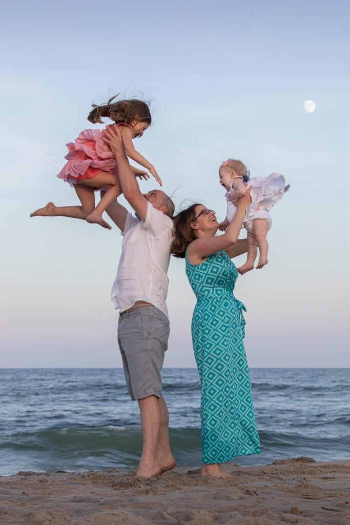 Family on the beach with moon over ocean  Corolla NC