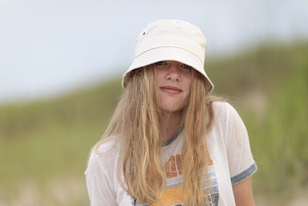 Vintage looking girl with hat on the beach in Duck, NC