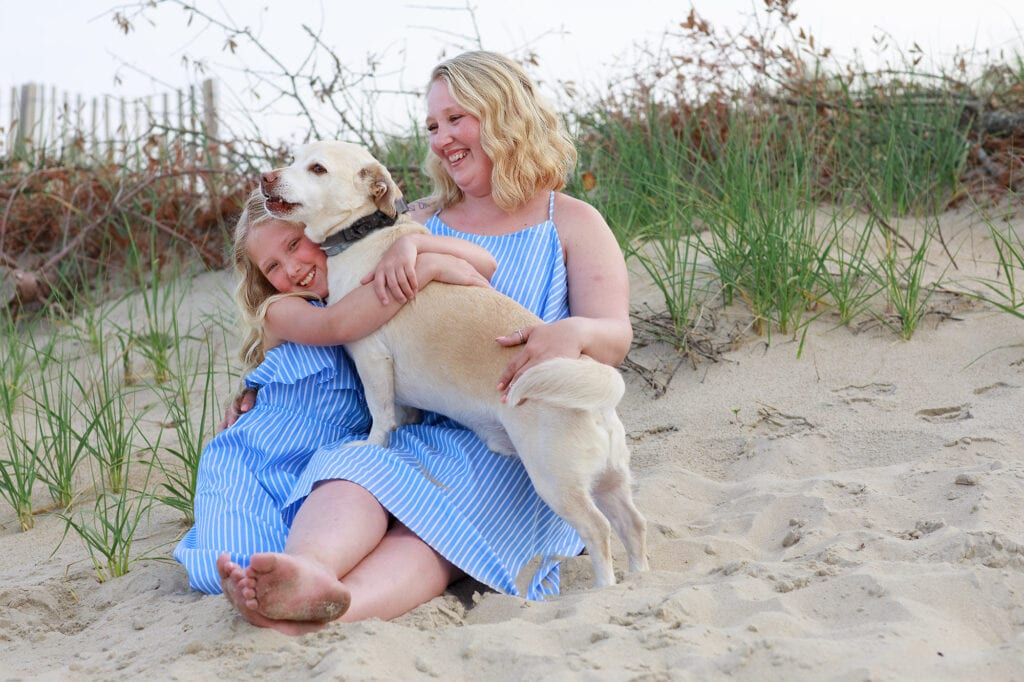 mother, daughter and dog on beach sanderling nc