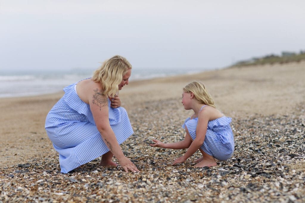 mother and daughter on beach in Sanderling nc