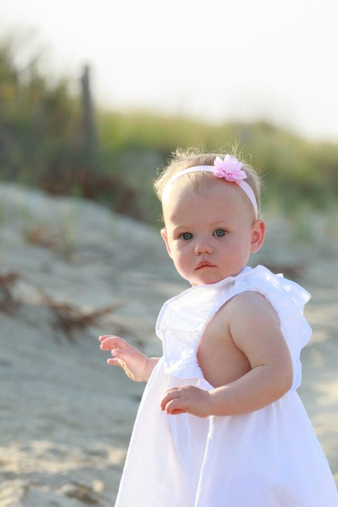 Beautiful little girl on the beach, Sanderling NC