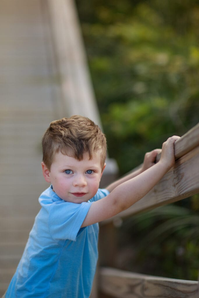 Little Boy on walk way to the beach, Duck NC