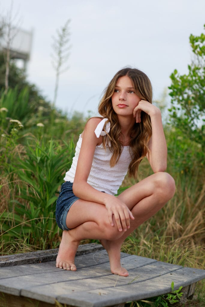 beautiful young girl surrounded by beach foliage Corolla NC