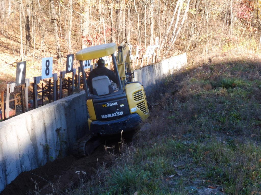 Jon excavating erosion @ 200 yard wall