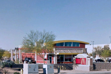 McDonalds storefront with cars at drivethrough