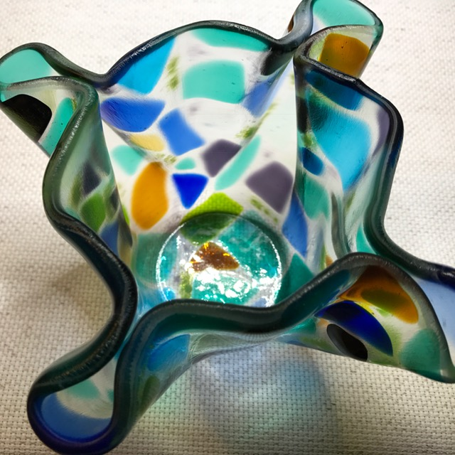 "#12806 BBGArt  $240.00  DescriptionL Glass fluted bowl/candle holder (multi-colored) original design & engraved  Size: 7"" round (slumped to 6-1/2"")  Item# 12806  $95.00"