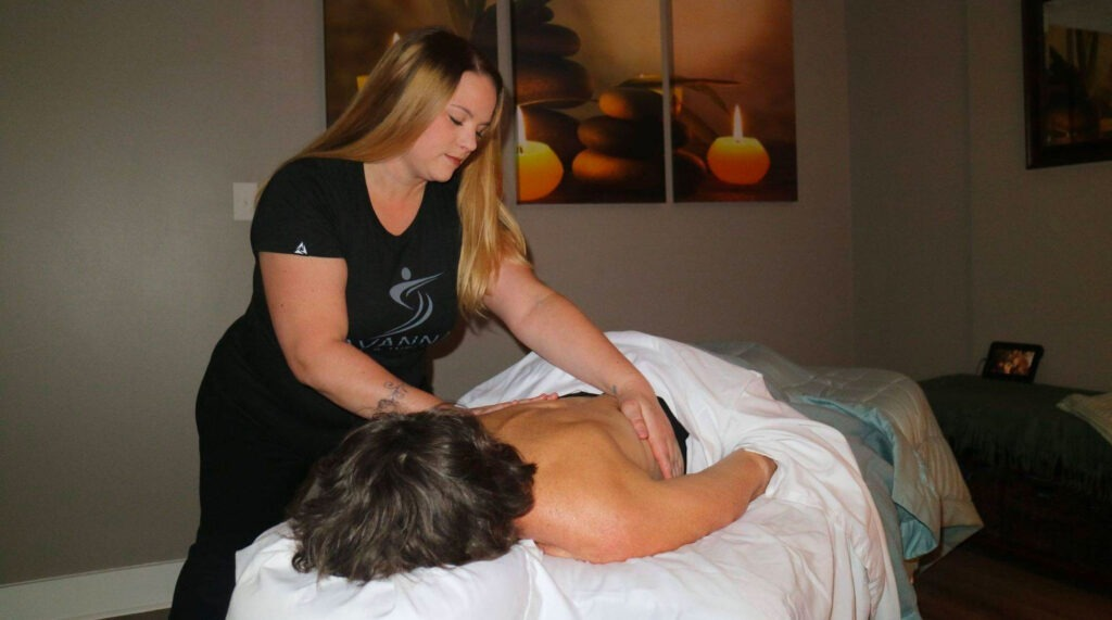 woman on massage table at Savannah Sport and Wellness