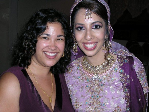 Picture of two women smiling. Felicia on the left and her friend Huma on the right.