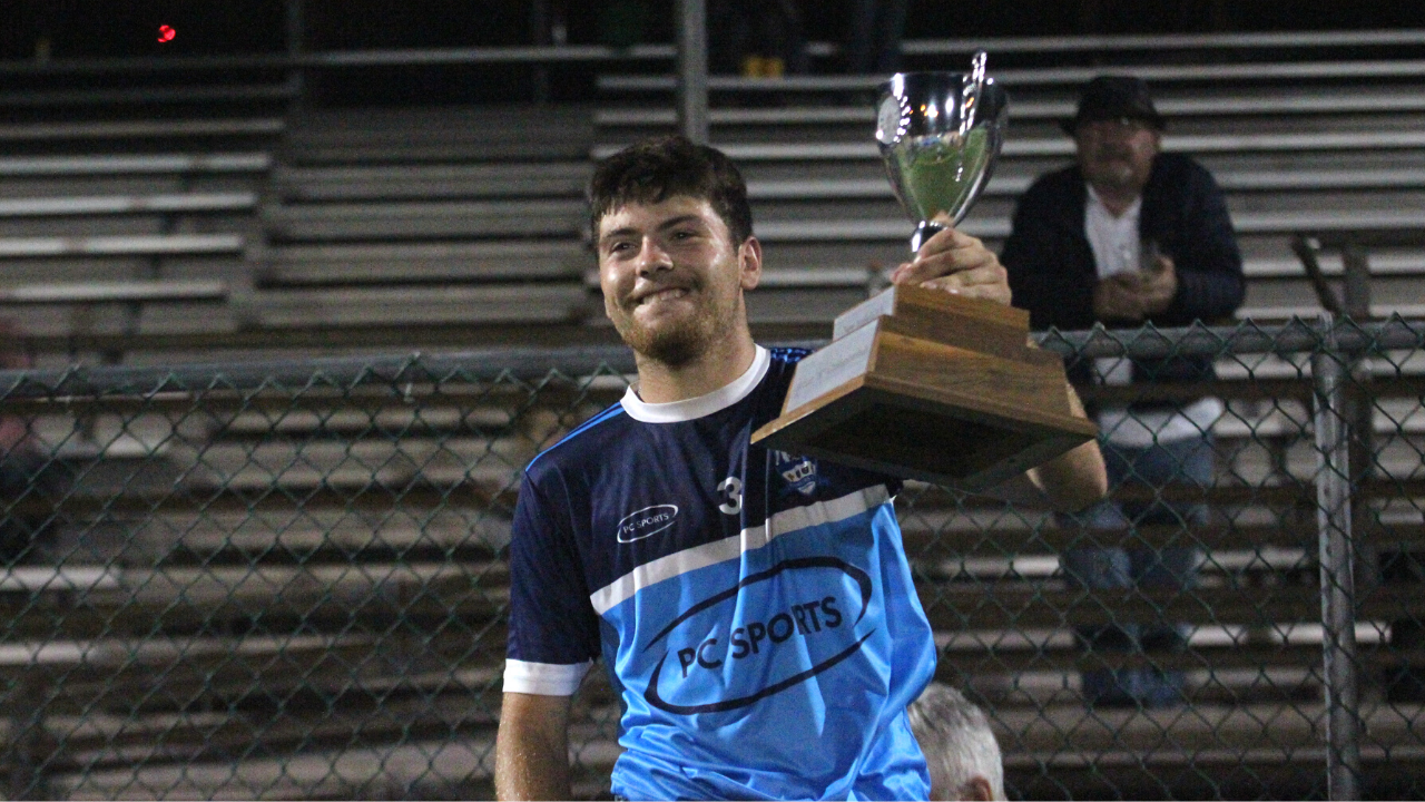 Rangers captain Dan Burke lifts the cup after Rangers GFC won the 2021 New York Junior B Football Final (Photo by Sharon Redican)