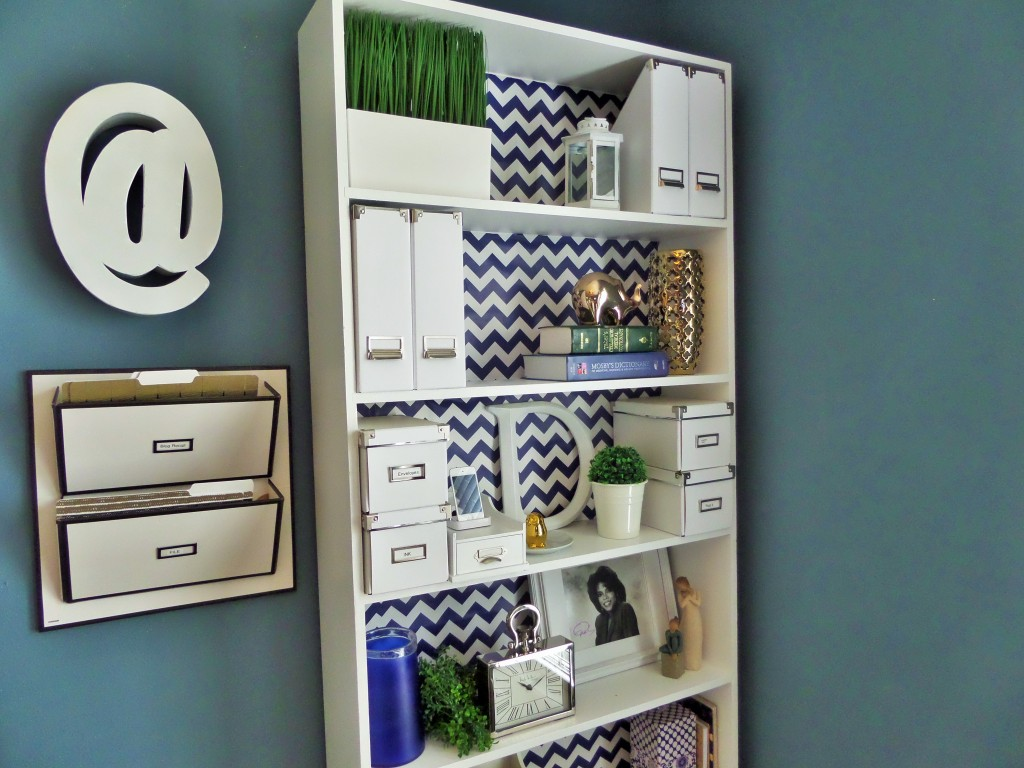 $3 Bookcase Makeover using gift wrap paper