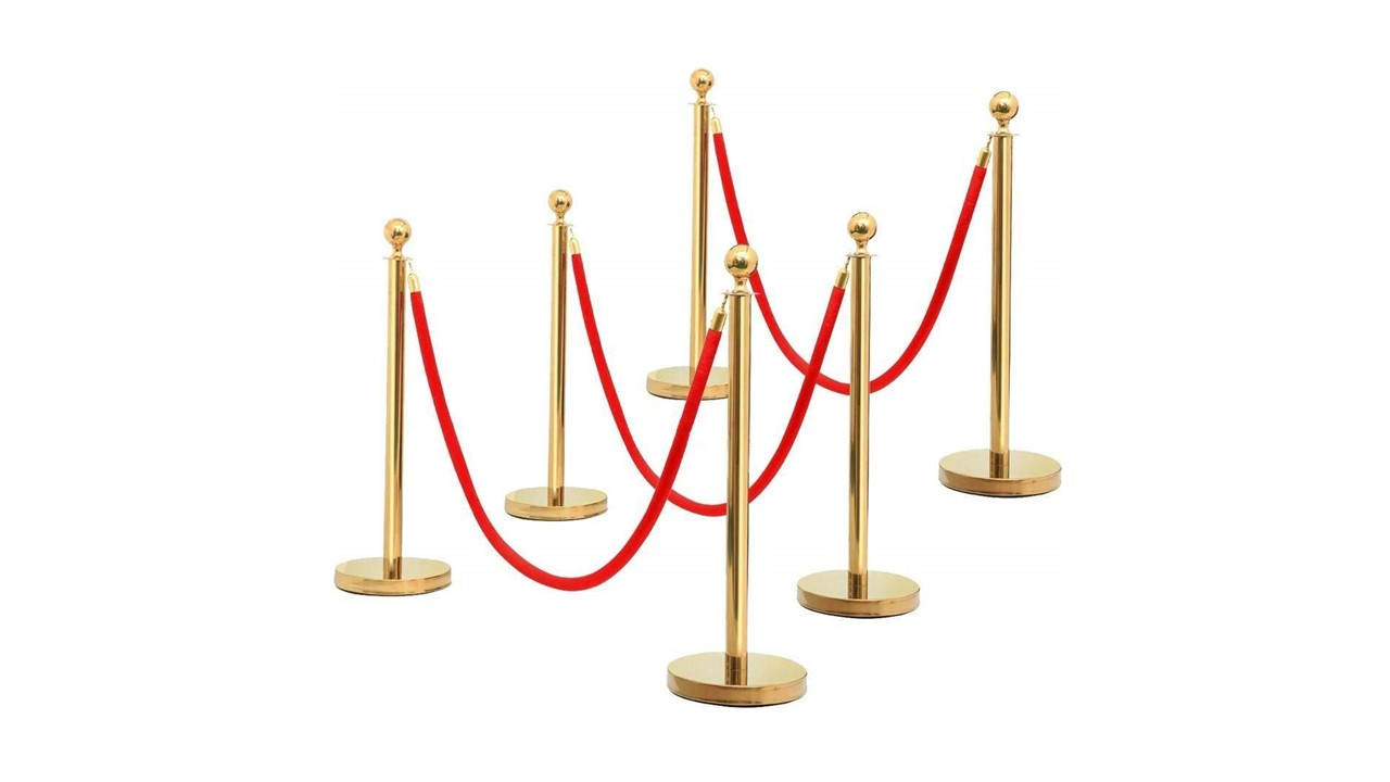 Gold stanchion with red rope