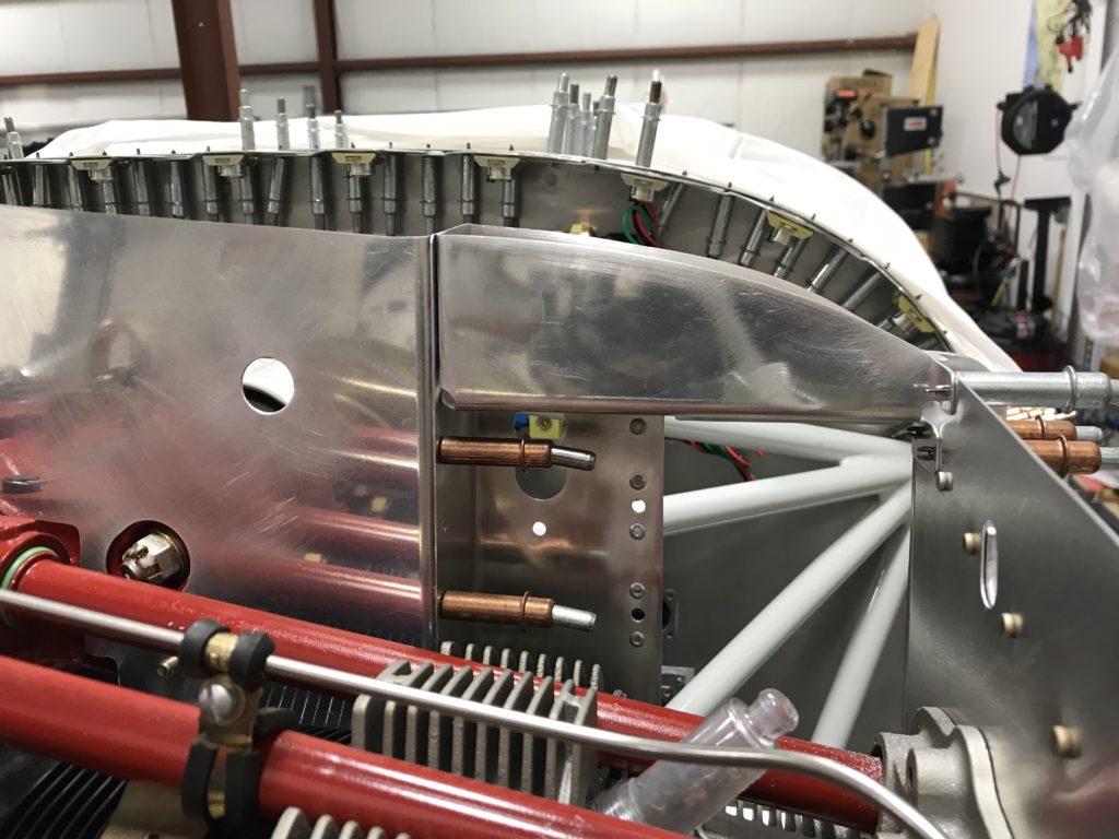Oil cooler reinforcement front flange trimmed