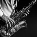 man playing saxiphone