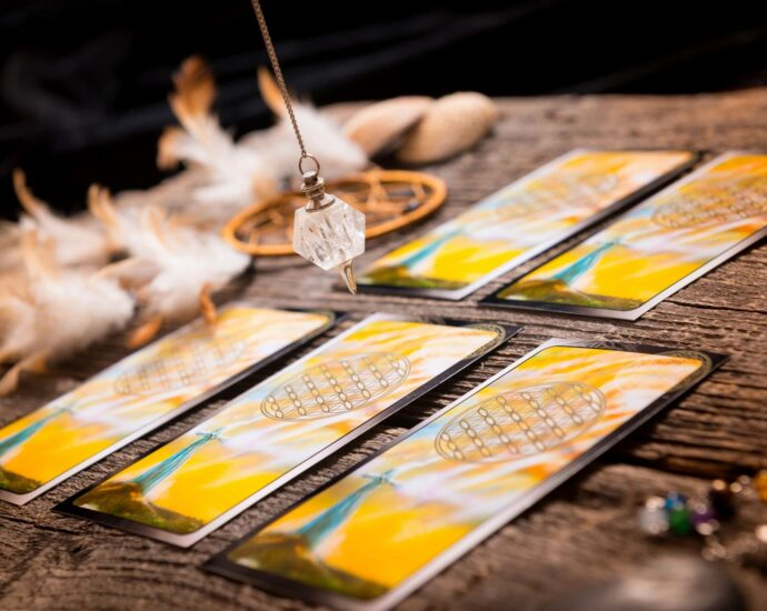 Tarrot cards and chicken feathers
