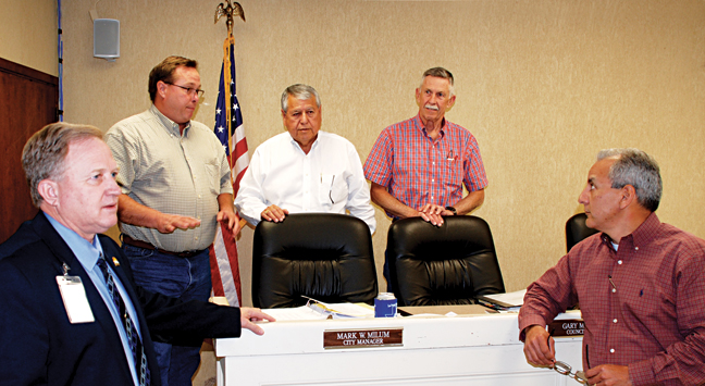 (l-r)Los Fresnos City Manager Mark W. Milum, Commissioner Alan Atherton, Mayor Polo Narvaez, Commissioners Gary Minton and Javier Mendez gather before heading in for executive session at their regular meeting last Tuesday night. Commissioner Swain Real was out of the room at the time of the photo and Mayor Pro-Tem Yolanda H. Cruz was not in attendance at the meeting.           LFN Photo