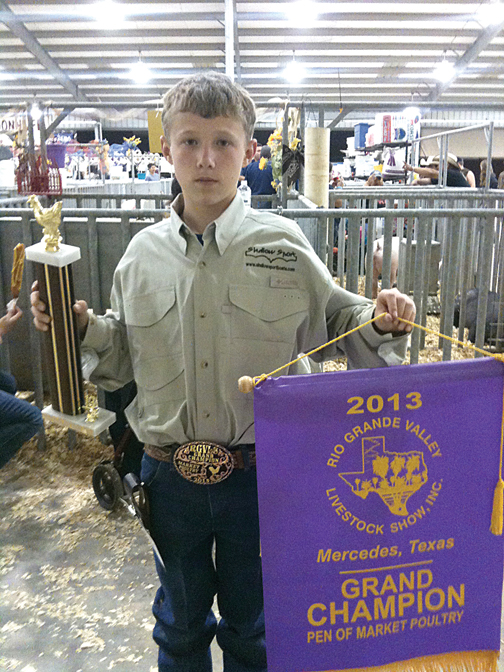 John Davidson holding his trophy and Grand Champion Pennant for Market Poultry