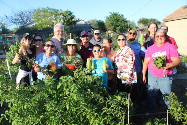 Members of Los Angeles Community Garden stand in front of the one of their plots. Photo: Tony Vindell/LFN