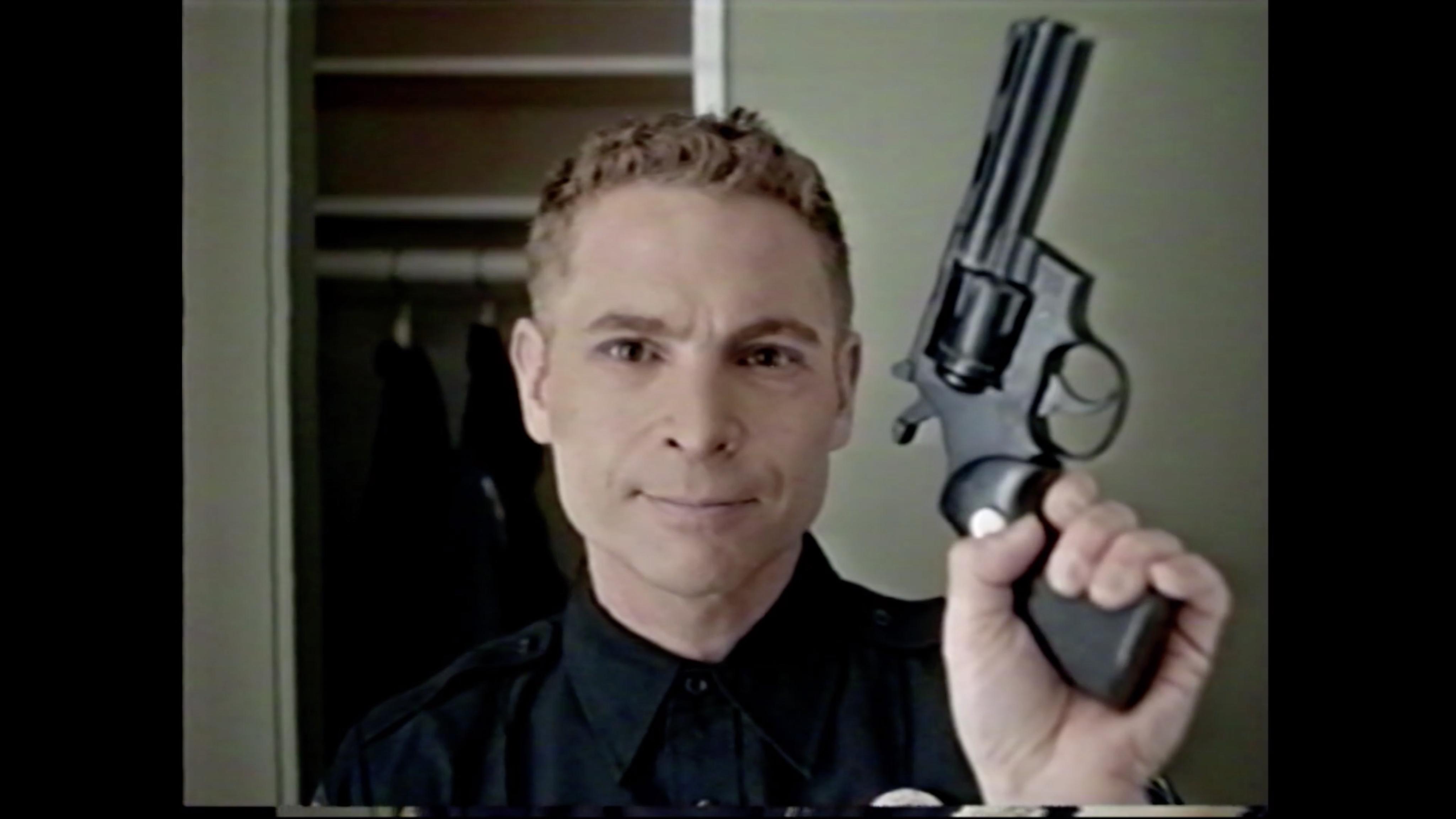 Jim Holding a Gun - Still from Survivial Skills