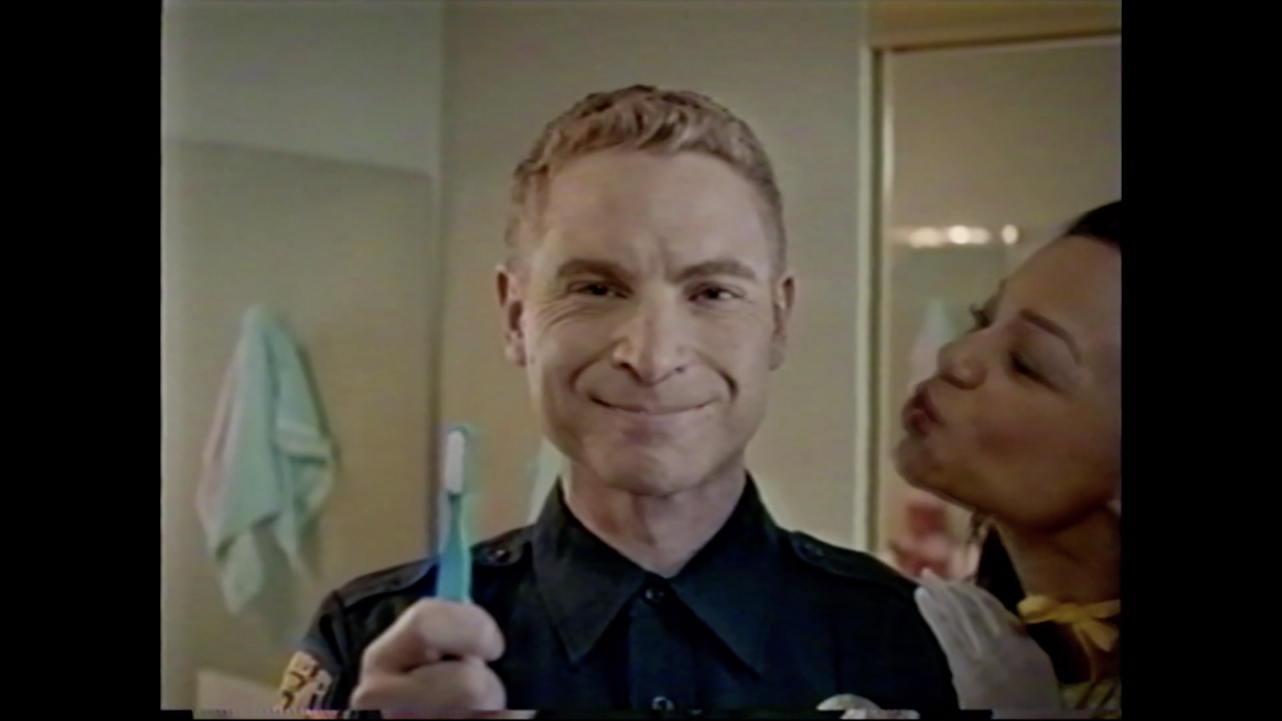 Jim with Toothbrush - Still from Survivial Skills
