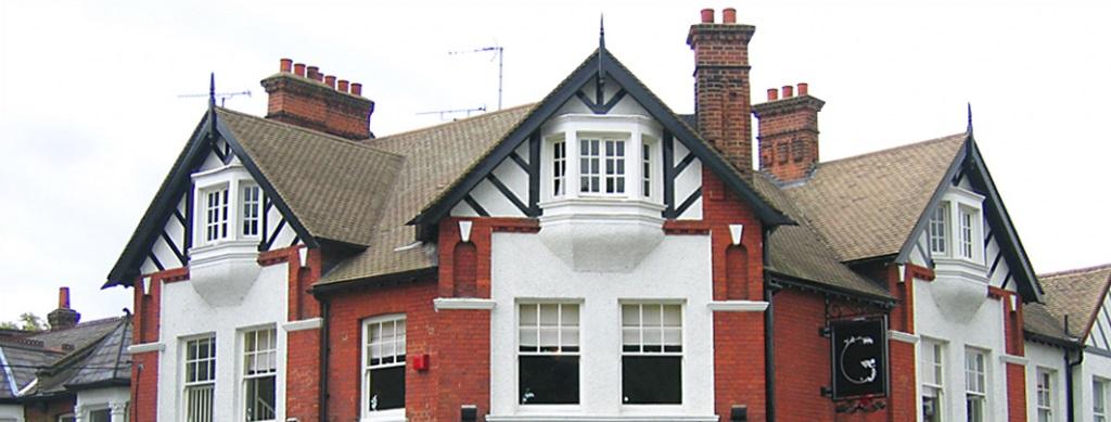 Corner heritage building with chimneys