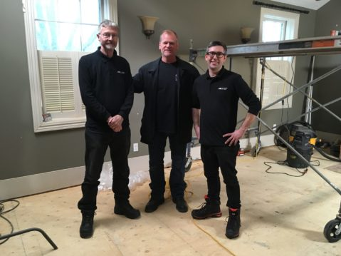 Our chimney technicians standing with celebrity contractor, Mike Holmes