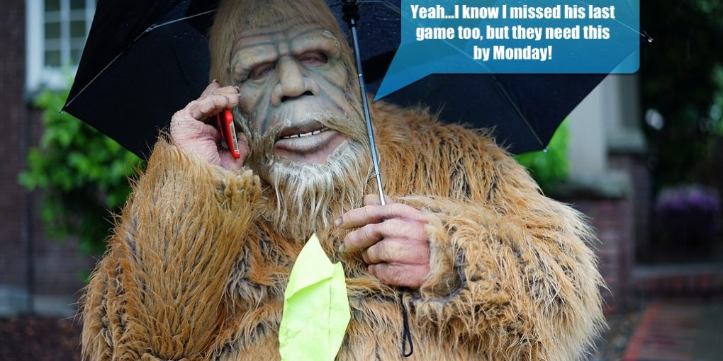 An image of someone in a sasquatch suit explaining to his wife that he'll miss another one of their child's games.