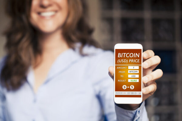 Bitcoin - Dollar converter app in a mobile phone screen.
