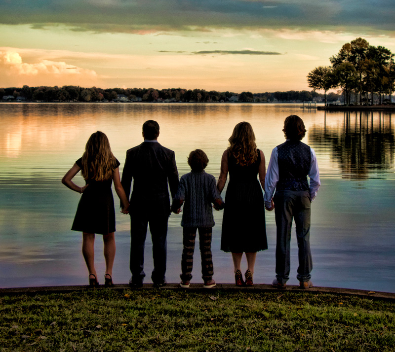 Deborah Young Photography - family gazing across Lake Norman at sunset