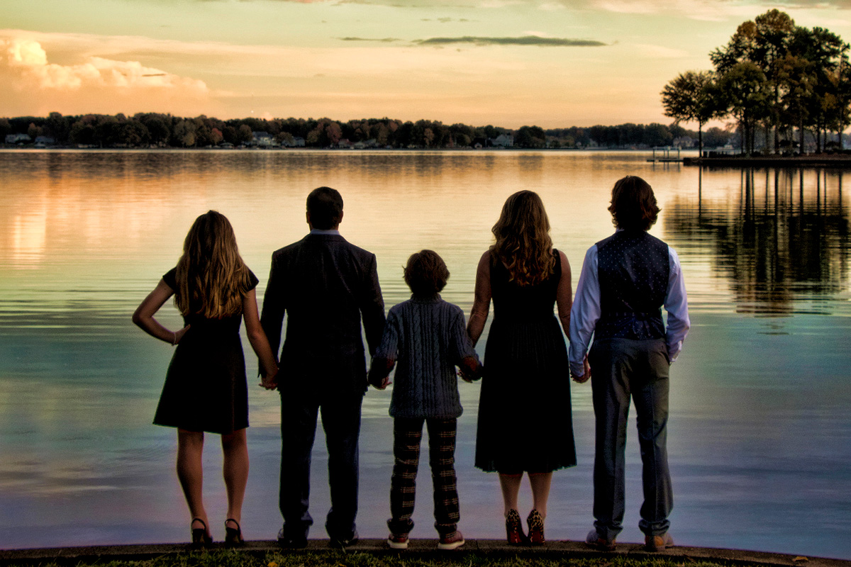 Family in front of Lake Norman at sunset