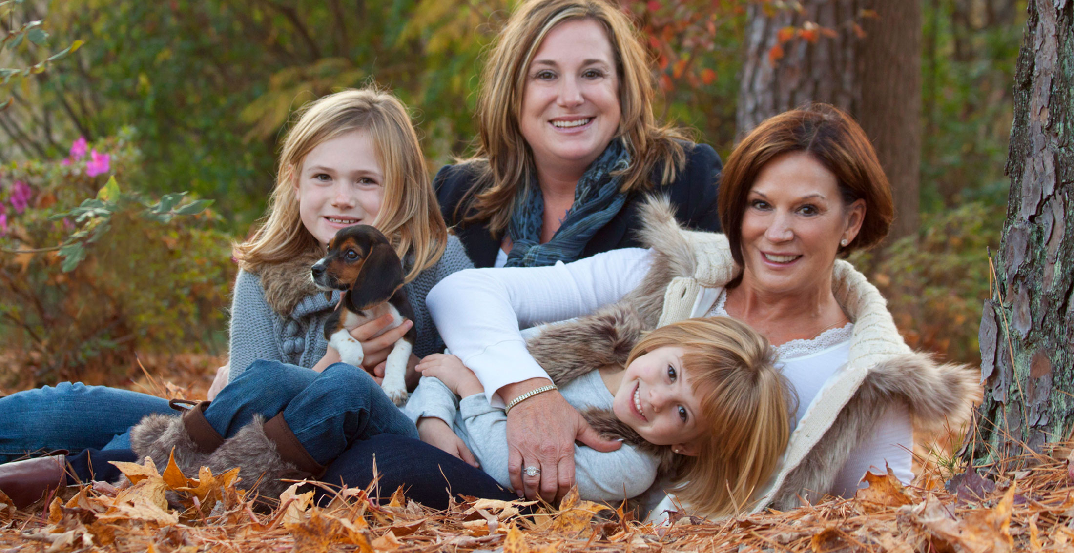 Deborah Young photo - family posing in woods, leaves