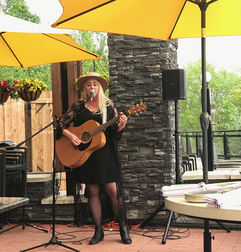 Jennifer Robbin sings on the Allora restaurant patio in Calgary
