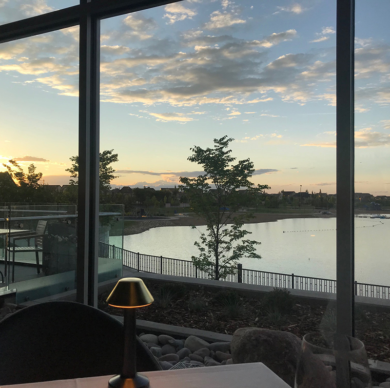 The sun sets over Mahogany Lake at Chairman's Steakhouse restaurant in Calgary