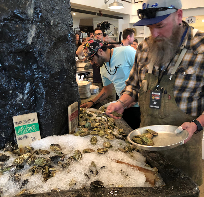 an oyster shucking competitor selects his oysters