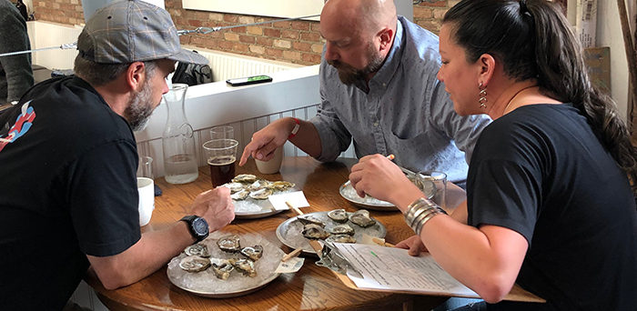 Judges at the Alberta Oyster Fest shucking competition deliberate at Rodney's restaurant in Calgary