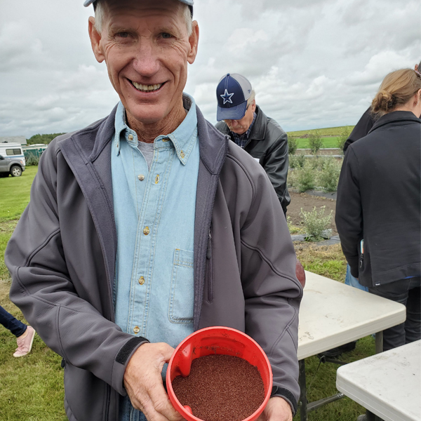 stettler farmer with rhodiola seeds