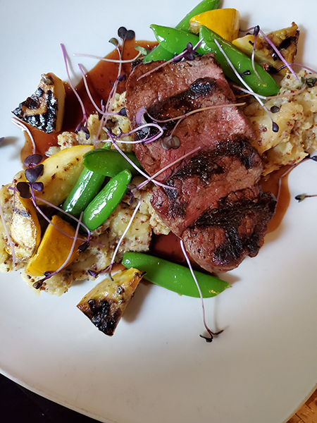 Canadian prime sirloin with mustard and thyme smashed fingerling potatoes, summer squash and snap peas