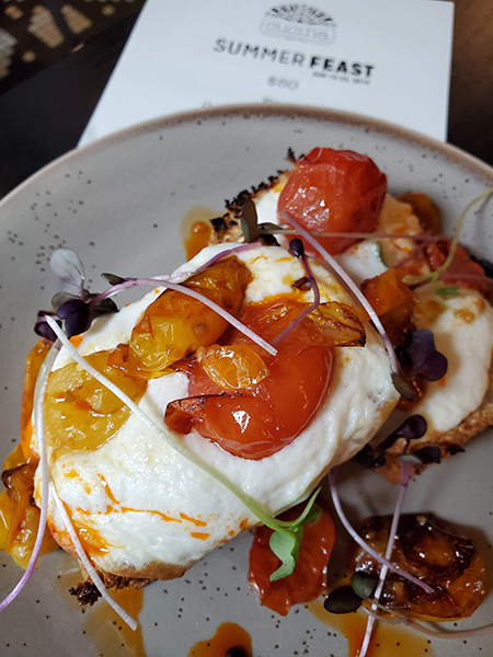 Focaccia with burrata, roasted heirloom tomatoes and chili oil