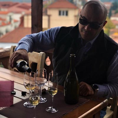 Georgian man pouring wine